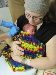 a little kangaroo care between rounds under the jaundice lights. six days old.